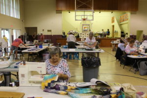 Irene Reising of Paducah, Ky., front, works amid other quilters at the retreat.