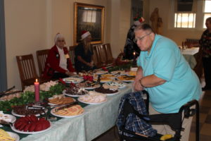 Sister Kathleen Dueber looks over the holiday goodies on display.