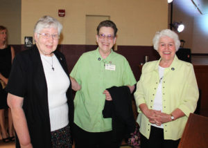 Sister Ruth Gehres, left, Sister Sharon Sullivan and Marian Bennett, coordinator of Ursuline Partnerships, await the start of the event.