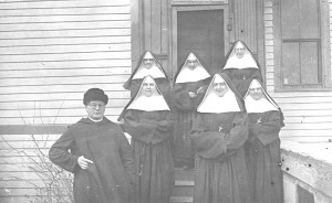 Ursuline teachers from Germany with their Benedictine pastor in the early days at St. Anthony, North Dakota.