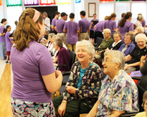 Sister Dorothy Helbling, right, and Sister Francis Louise Johnson smile after talking to this camp member.