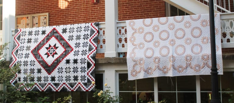 Each year, participants hang completed quilts on the railing of the Retreat Center courtyard for everyone to enjoy.