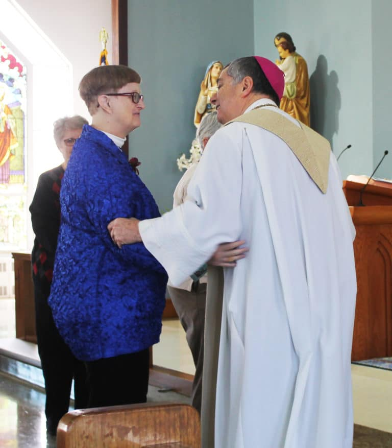 Sister Rebecca White, celebrating 40 years, receives her thanks from the bishop.