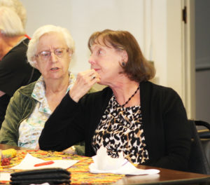 Sue Gibbons, right, listens to a point made by Sister Eva Boone.