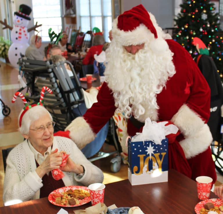 Santa brings a little joy to Sister Clarita Browning.