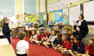 One of Stephany's top spellers displays her skills in front of the first-grade class at St. Joseph School on May 21.