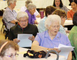 "Ursuline Sisters George Mary Hagan, left, and Joan Walz sing along with ""Glory Sing to the Lord."""