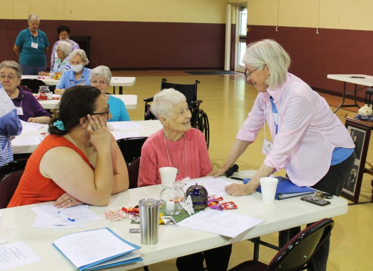 Sister Nancy Liddy, right, talks with Sister Marcella Schrant, center, and Associate Renee Schultz in the morning. Sister Marcella was honored during trivia for her 75th jubilee in 2020.