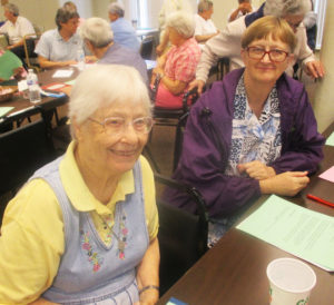 Sister Marcella Schrant, left, and Sister Rebecca White take part in a discussion on July 13.