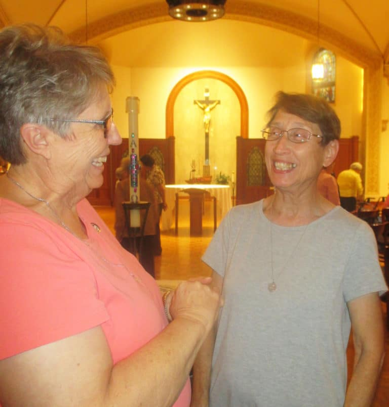 Sister Betsy Moyer, left, shares a laugh with Sister Marilyn Mueth following the opening of Community Days.
