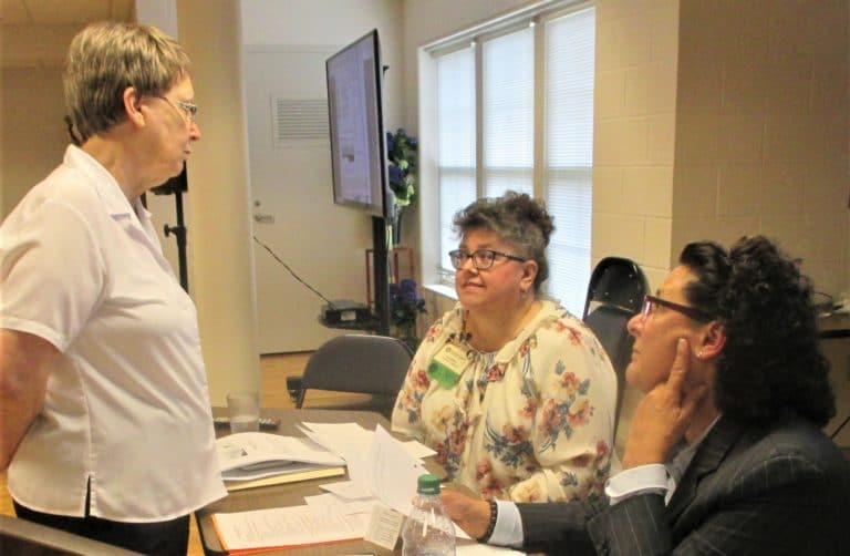 Sister Amelia Stenger, left, the congregational leader, talks with Martha Alle, director of Finance for the Sisters, and Carolyn Larocco during a break.
