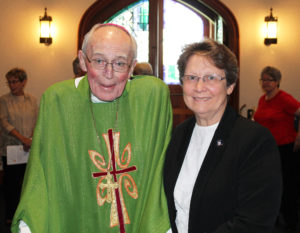 Bishop Emeritus John McRaith poses with Sister Amelia prior to Mass. The two have been friends since Sister Amelia was superintendent of schools for the Diocese of Owensboro beginning in 1984.
