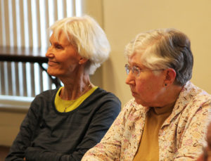 "Mary Helen Nash, left, and Sister Ruth Gehres listen to Sister Amelia recount that when she became the Center director in 1997, she began an environmental education program utilizing the Mount farm. ""It's impossible to believe that some kids had never seen live cows and pigs,"" Sister Amelia said."