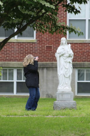 Rebecca McCubbins gets up close and personal with the statue of Saint Agnes.