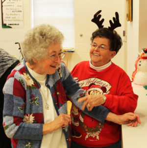 Sister Teresa Riley, left, and Associate Phyllis Troutman laugh at the party. Phyllis and Sister Mary Lois Speaks came from central Kentucky to join the fun.