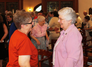 Sister Betsy Moyer, left, shares a smile with Sister Pat Lynch following the prayer service.