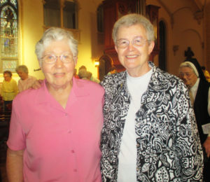 Long-time friends Sister Ruth Gehres, left, and Sister Michele Morek pose following the final Mass. The two served together for many years at Brescia College/University.